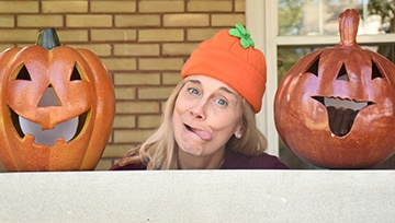 Doctor making funny face with pumpkins