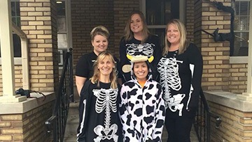 Staff dressed in skeleton costumes