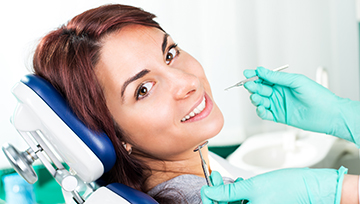 Woman in dental chair during treatment