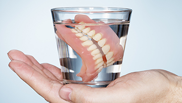 Full dentures in a glass of water
