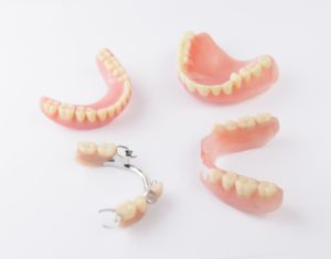 Four denture restorations.